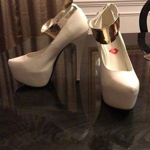 White leather stilettos